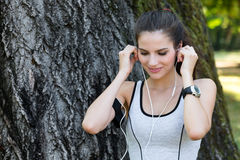 Female runner listening to music with Earphones Royalty Free Stock Photos