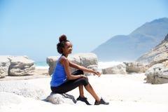 Female runner relaxing at the beach Stock Image