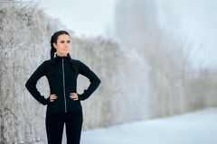 Winter Sport Woman in Outdoor Fitness Session. Female runner resting before fitness exercise session outside Royalty Free Stock Images