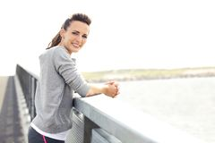 Female Runner Resting and Looking At You Royalty Free Stock Photography