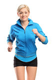 A female runner running Stock Photography