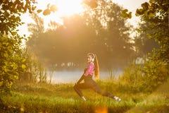 Female runner running in nature during sunrise royalty free stock image