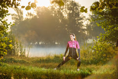 Female runner running in nature during sunrise Stock Images