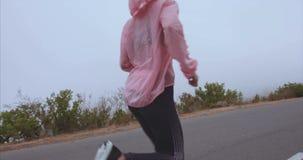 Female runner running outdoor in morning stock footage