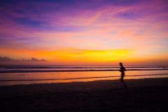 Female runner silhouette Stock Photos
