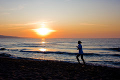 Female runner silhouette  with a sunse Royalty Free Stock Photography