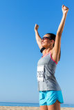 Female runner with start number showing winning attitude. Royalty Free Stock Images