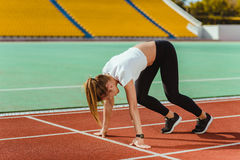 Female runner in start position Royalty Free Stock Photos