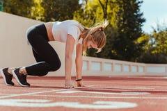 Female runner in start position Stock Images