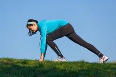 Female runner in start position Royalty Free Stock Photo
