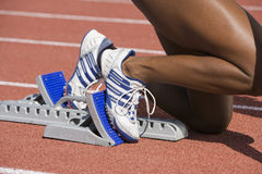 Female Runner On Starting Blocks Royalty Free Stock Photos