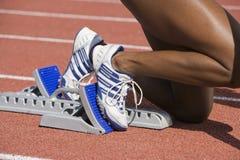 Female Runner On Starting Blocks Royalty Free Stock Photos