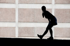 Female runner stretches in the morning. Royalty Free Stock Image
