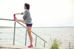 Female Runner Stretching Her Legs Royalty Free Stock Image