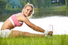 Female runner stretching before her workout Stock Photo