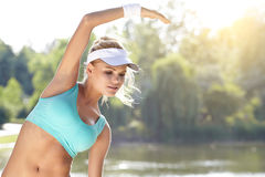 Female runner stretching before her workout Royalty Free Stock Photos