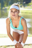 Female runner stretching before her workout Royalty Free Stock Image