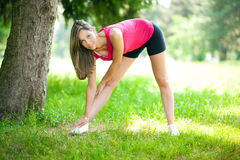 Female runner stretching before her workout Royalty Free Stock Photo