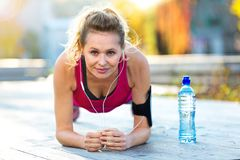 Female Runner Stretching. Before jog Royalty Free Stock Image