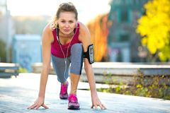 Female Runner Stretching. Before jog Royalty Free Stock Photography
