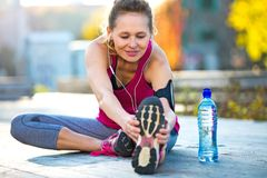 Female Runner Stretching. Before jog Royalty Free Stock Photo