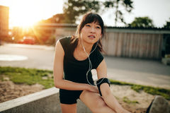 Female runner stretching legs before running workout Royalty Free Stock Image