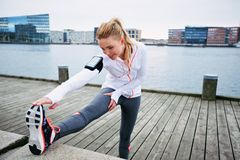 Female runner stretching before a run Stock Photo