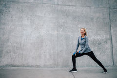 Female runner stretching after running session Stock Images