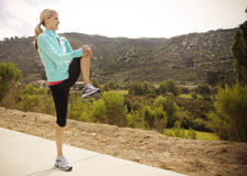 Female Runner Stretching before Workout Stock Photography