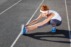 Female runner stretching before Royalty Free Stock Images