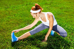 Female runner stretching before Stock Photography