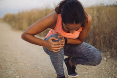 Female runner suffering from knee injury Stock Photography