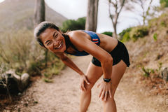 Female runner taking a break after running workout Royalty Free Stock Photo