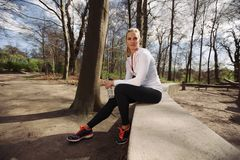Female runner taking a rest from training in nature Royalty Free Stock Images