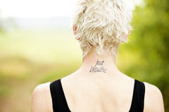 Female runner with tattoo on her neck. View of female runner back with tatoo just breathe on her neck royalty free stock images