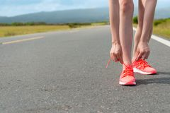 Female runner tying shoelace ready to workout Stock Photography