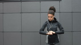 Female runner using activity tracker. After workout stock video