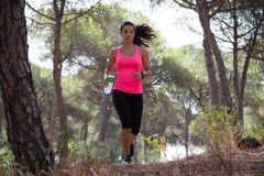 Female runner with water bottle and GPS watch Stock Photos
