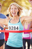 Female Runner Winning Marathon Stock Photography