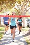 Female Runner Winning Marathon. Female Runner Running Towards Camera Winning Marathon Royalty Free Stock Photo