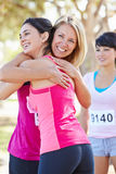 Female Runners Congratulating One Another After Race Royalty Free Stock Photography
