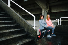 Female runners doing leg lunges  workout Royalty Free Stock Photo