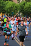 Female runners dressed in costume Royalty Free Stock Image