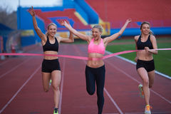 Female Runners Finishing Race Together Royalty Free Stock Images