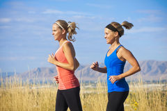 Female Runners on a jog Stock Image