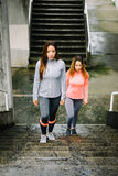 Female runners ready for hiit urban stairs workout Royalty Free Stock Image