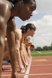 Female Runners At Starting Line royalty free stock photography