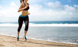 Female running on beach Stock Photography