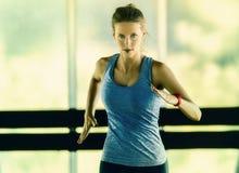 Female running corridor Stock Photography