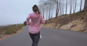 Female running on country road stock video